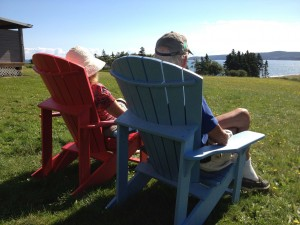 Suzanne and Trond relaxing in chairs overlooking the lake in Nova Scotia